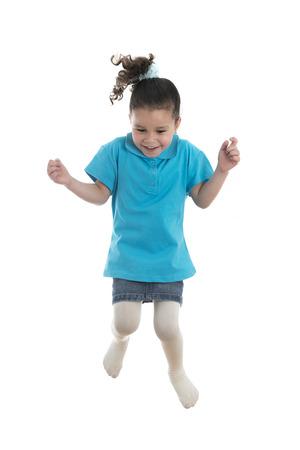 hopping: Active Joyful Little Girl Jumping with Joy Isolated on White Background