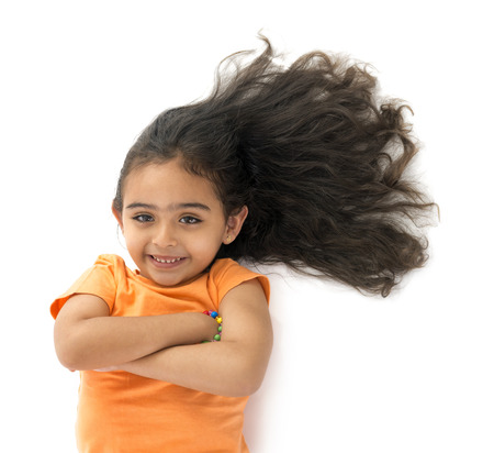 pervasive: Young Girl with Beautiful Hair Isolated on White Background Stock Photo