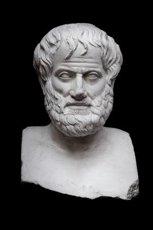 黒の背景に分離されたギリシャの哲学者アリストテレスの彫刻 写真素材