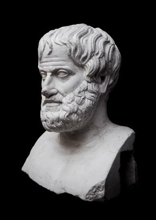 Philosopher Aristotle Sculpture Isolated on Black Background photo