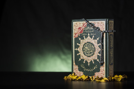 Subha and Islamic Book Holy Quran on Soft Light Background Stok Fotoğraf