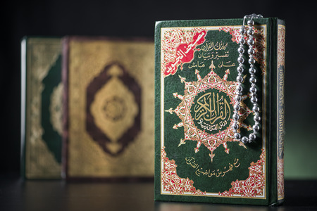 recite: Islamic Books of Holy Quran on Soft Light Background