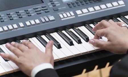 Musician Hands Playing Electronic Piano Keyboard photo