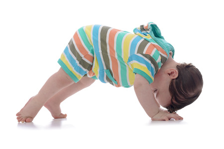 Crawling Baby Looking Backwards Isolated on White Background Foto de archivo