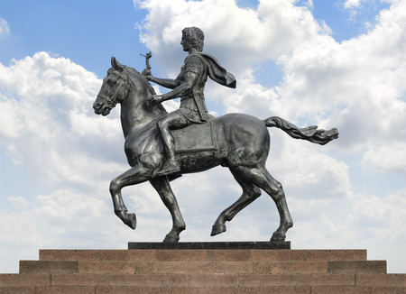 alexander the great: Statue of Alexander The Great Riding on His Horse over Blue Sky