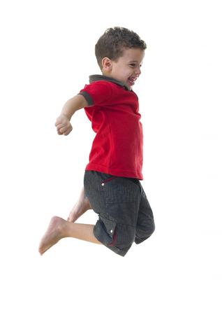 Active Joyful Boy Jumping Isolated on White Background Standard-Bild