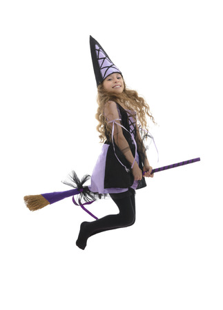 white socks: Happy Beautiful Witch Girl Flying With Broom Isolated on White Background
