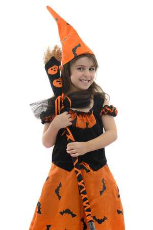 fancy dress party: Happy Witch Girl With Broom Isolated on White Background Stock Photo