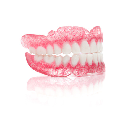 dental resin: A Set of Dentures Isolated on White Background Stock Photo