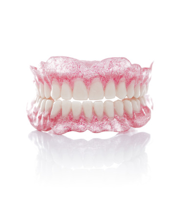 surrogate: A Set of Full Dentures Isolated on White Background Stock Photo