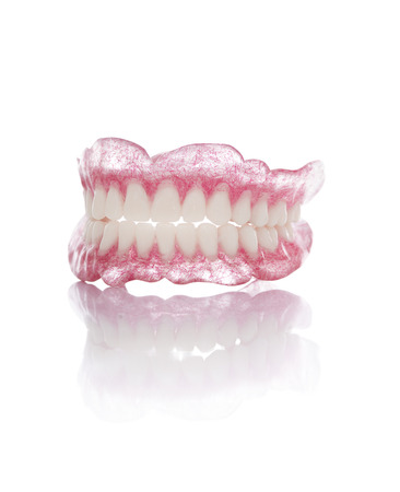 dental resin: A Set of Artificial Dentures Isolated on White Background