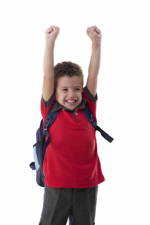 schoolbag: Young Happy Schoolboy Isolated on White Background