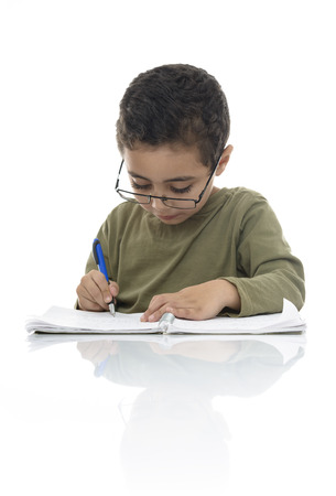 Cute Young Schoolboy Studying with Concentration Isolated on White Background photo