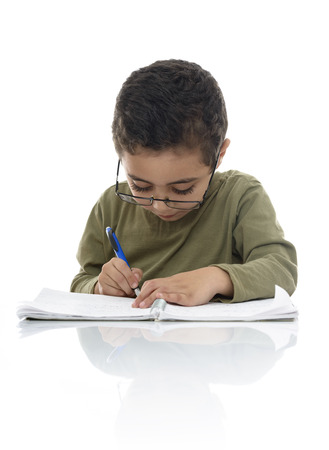 studious: Young Schoolboy Studying with Concentration Isolated on White Background Stock Photo