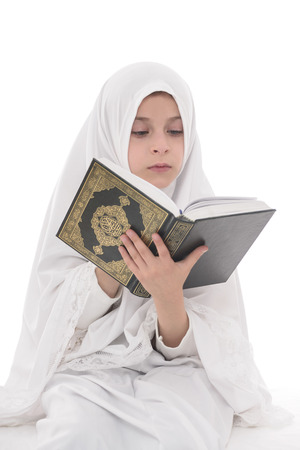 quran: Pretty Muslim Girl Studying Holy Book of Quran Isolated on White Background