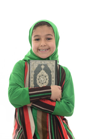 quran: Little Young Muslim Girl Loves Holy Quran Isolated on White Background