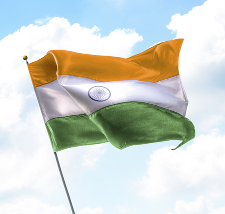 color paper: Flag of India Raised Up in The Sky Stock Photo