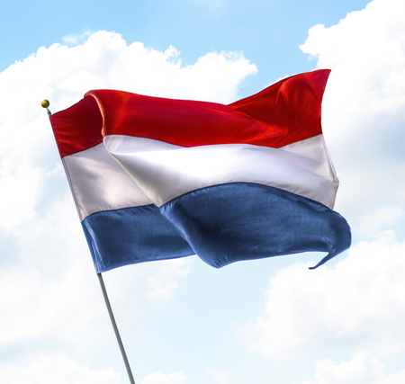 dutch: Flag of Netherlands Raised Up in The Sky