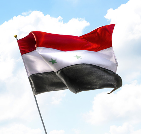 old postcards: Flag of Syria Raised Up in The Sky Stock Photo