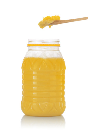 ghee: Jar of Pure Indian Ghee with Spoon Isolated on White Background