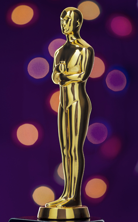 statuette: Shiney Golden Statuette on Defocused Lights Background
