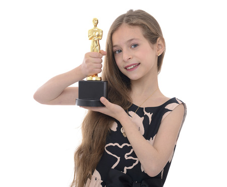 nominations: Winner Girl Holding Trophy Isolated on White Background