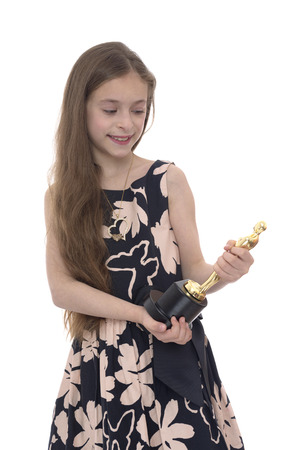 nominations: Girl Looking at Trophy Isolated on White Background Stock Photo