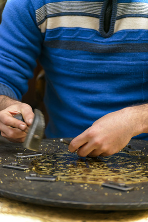 engraver: Two Hands of Craftsman Engraving Decorative Brass Masterpiece
