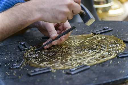 engraver: Two Hands of Craftsman Engraving Brass Plate Masterpiece