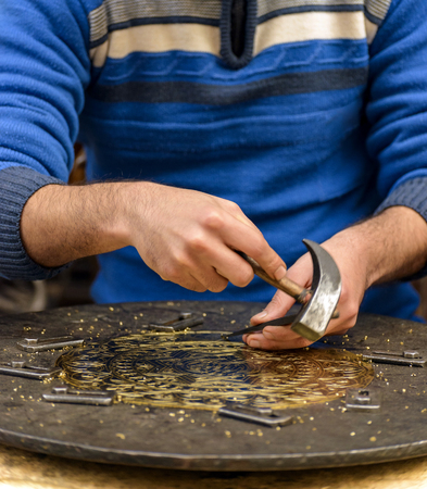 engraver: Two Hands of Craftsman Engraving Decorative Brass Plate