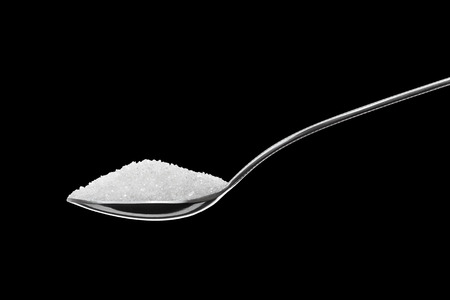 Spoon Full of Sugar Isolated on Black Background