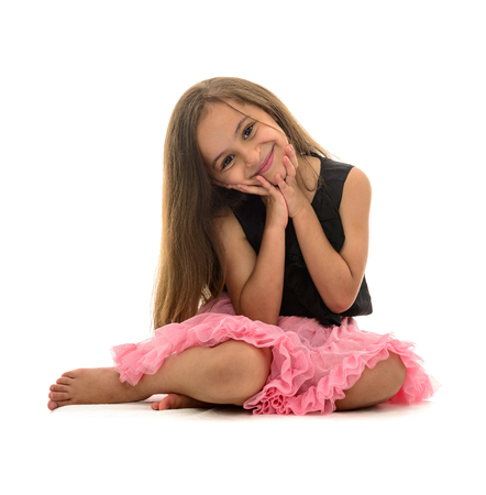 girl sitting down: Beautiful Young Smiling Girl Sitting Down Isolated on White Background