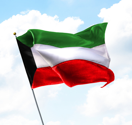 statehood: Flag of Kuwait Raised Up in The Sky Stock Photo