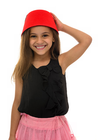 hairy: Beautiful Young Girl With Beautiful Smile Wearing a Fez Isolated on White Background Stock Photo