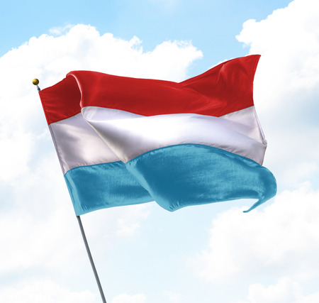 Flag of Luxembourg Raised Up in The Sky
