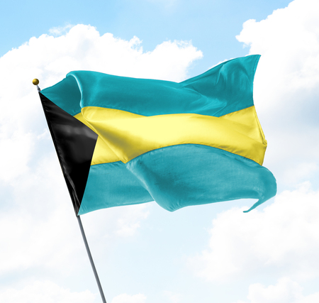 bahama: Flag of Bahamas Raised Up in The Sky Stock Photo