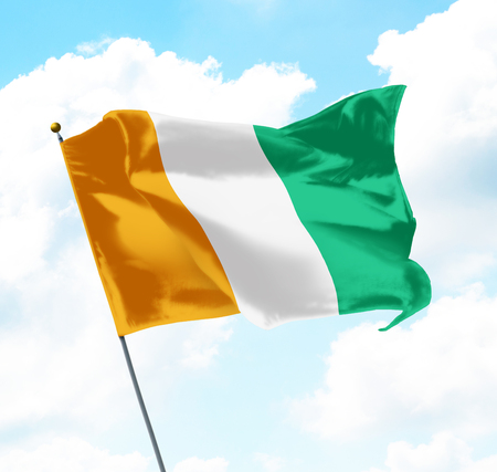 Flag of Ivory Coast Raised Up in The Sky Stock Photo