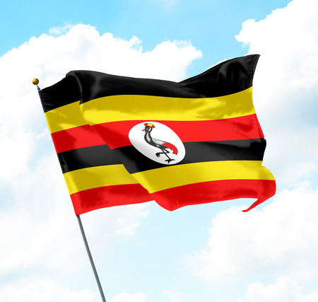 ugandan: Flag of Uganda Raised Up in The Sky