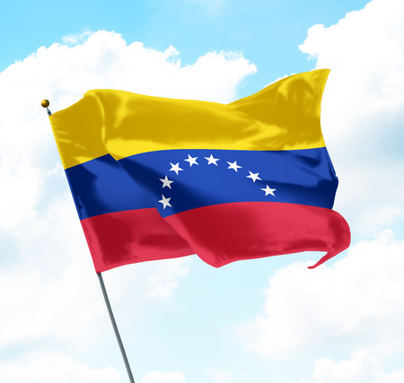 Flag of Venezuela Raised Up in The Sky Foto de archivo