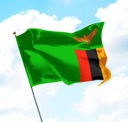 Flag of Zambia Raised Up in The Sky