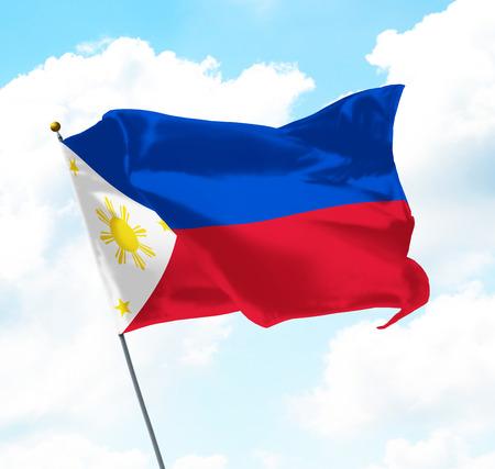 空に上がるフィリピンの旗 写真素材