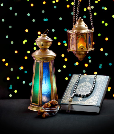 A Collection of Ramadan Celebration Symbols, Lantern, Dates and Quran Stock Photo - 74955319