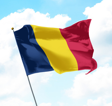chadian: Flag of Chad Raised Up in The Sky Stock Photo