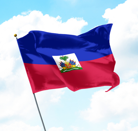 haiti: Flag of Haiti Raised Up in The Sky Stock Photo