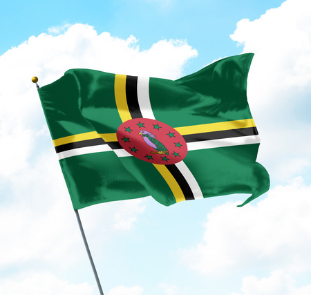 Flag of Dominica Raised Up in The Sky Stock Photo