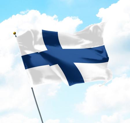 空に上がるフィンランドの旗 写真素材
