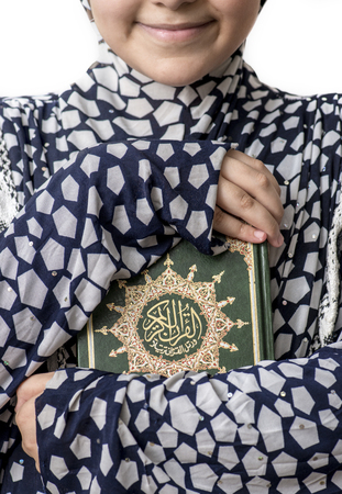Young Muslim Girl Huging Holy Book of Quran