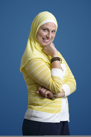 Happy Confident Beautiful Muslim Woman over Blue Background