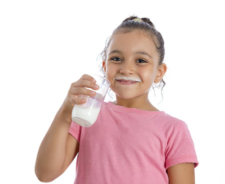 Pretty Young Girl with Milk Mustache Drinking Milk Isolated on White Background