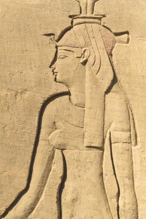 Egyptian Pharaoh Queen Engraved on Stone Wall